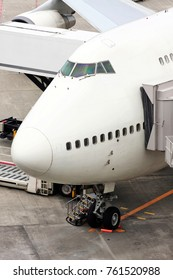 Airplane at gate being serviced in preparation for boarding
