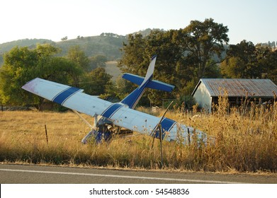 Airplane had a forced landing in a field, out of fuel, no injury, Roberts Creek Rd. Roseburg, OR