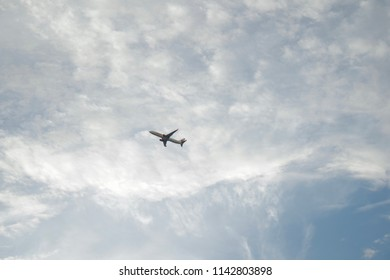 Airplane high speed on the clounds blue sky