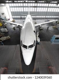 Airplane inside aerospace hangar ready for repair and overhaul