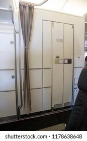 Airplane interior with lavatory.
