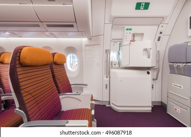 Airplane interior, seats, window and Emergency exit on an aircraft, view from inside of the plane.