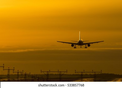 Airplane landing to airport runway in winter