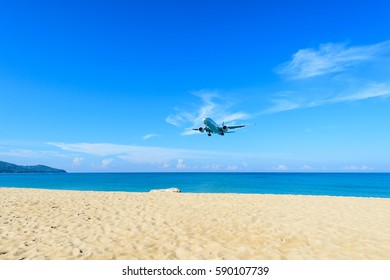 The airplane landing at the beach nearby (Phuket) International Airport, south of Thailand.
