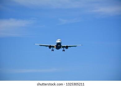 Airplane Landing - Blue Sky