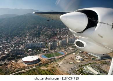 a airplane landing at the Caracas Airport at the coast of Caracas in the north of Venezuela.   Venezuela, Caracas, November, 2005