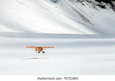 An airplane landing on Aletsch Glacier, Berner Oberland, Switzerland