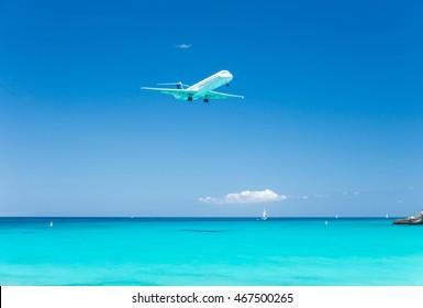 Airplane landing at Saint Maarten International Airport