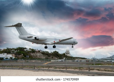 Airplane landing in St. Maarten Island, Dutch Antilles.