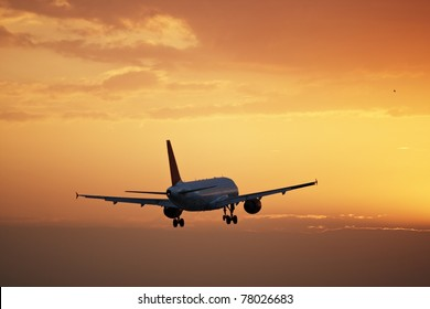 Airplane is landing at sunset, Prague Ruzyne Airport