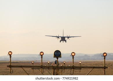 Airplane is landing using airport's navigation system