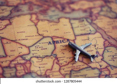 Airplane miniature aiming to Africa on map. Travel to Africa concept.