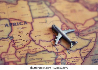 Airplane model on Sudan, Africa (map). International flights to Sudan concept.