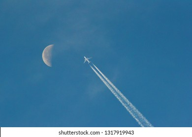 airplane and moon in daytime