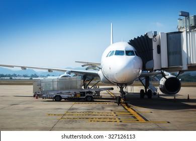 Airplane near terminal.