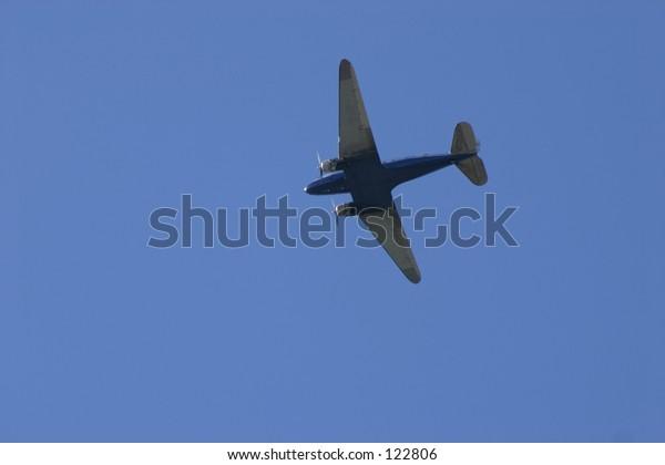 An airplane on a blue sky
