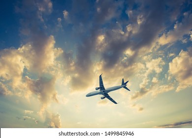 Airplane on blue sky and clouds, fly concept