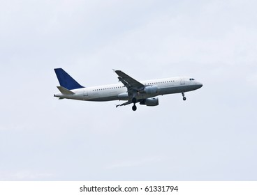 Airplane on a cloudy sky
