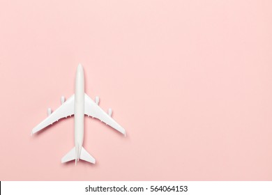airplane on color background