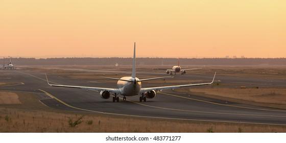 airplane on a starting runway evening sundown