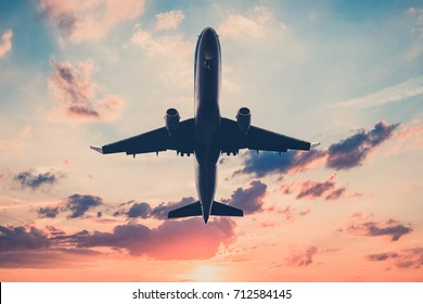 airplane on sunset sky  - aircraft, jet  on scenic sky background