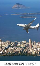 Airplane over Ipanema beach in Brazil