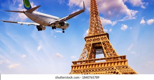 Airplane overflying Eiffel Tower in Paris.