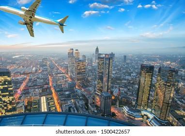 Airplane overflying Frankfurt, Germany - Europe