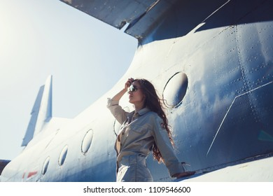 Airplane pilot: fashion model with sunglasses aviator