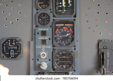 Airplane Pilot's Cockpit with Center Control Panels. Closeup high detailed view on engine power control and other aircraft control unit in the cockpit of modern civil passenger airplane.