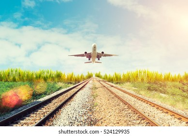 Airplane and railway at sunset. Travel or  Transporttation background concept.