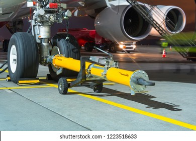 Airplane ready for push the back the cart tow tracktor on the front landing gear of the chassis