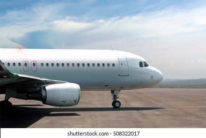 Airplane ready to take off from side view