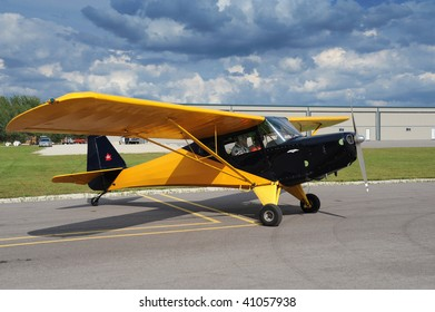 Red Airplane Moored On Airfield Stock Photo (Edit Now) 40996363