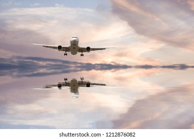 Airplane reflection in water