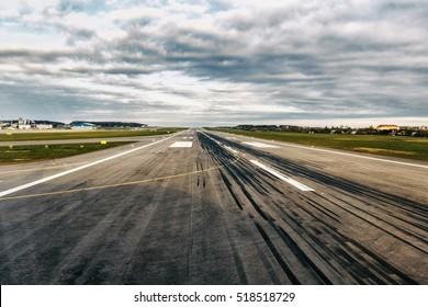 Airplane runway. Detail of runway with pattern of wheels