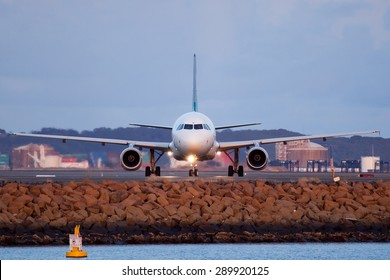 An airplane is seen here in Sydney airport vacating the runway.