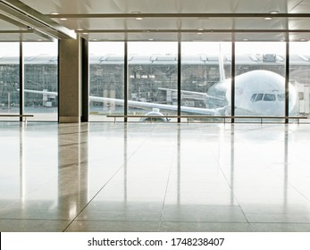 Airplane seen through window in airport terminal
