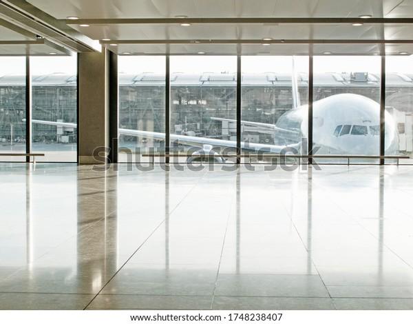 Airplane seen through window in airport terminal