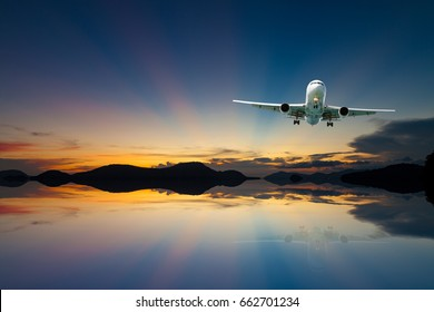 airplane in the sky with reflex beautiful sunset,concept open season tour and travel background