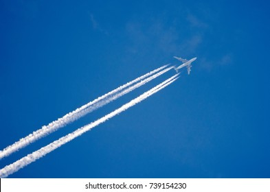 Airplane in the sky with a trace of steam contrail