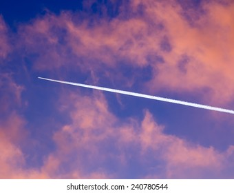 airplane smoke tail in the Sky