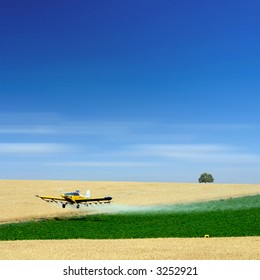 airplane spraying a field