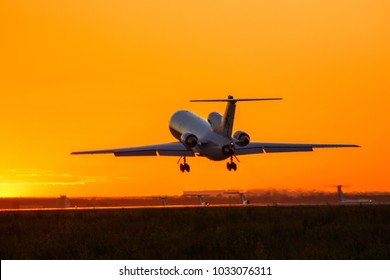 Airplane at sunset - back lit