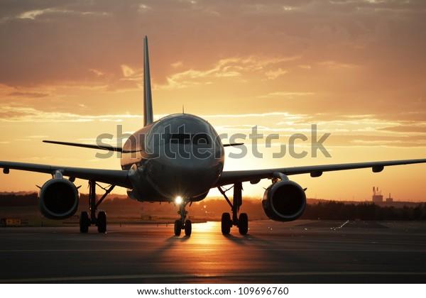 Airplane at sunset - back lit