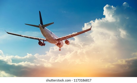 Airplane in the sunset sky flight travel transport airline background concept. - Shutterstock ID 1173186817