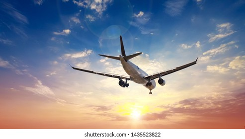 Airplane in the sunset sky flight travel transport airline background concept. - Shutterstock ID 1435523822