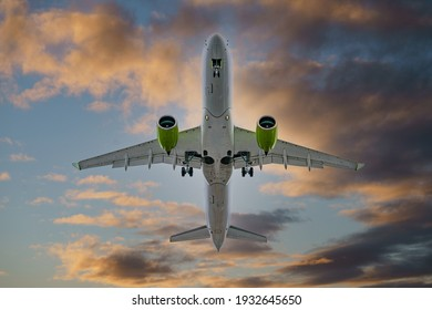 Airplane in the sunset sky flight travel transport airline background concept..