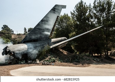 an airplane tail in a plane crash site
