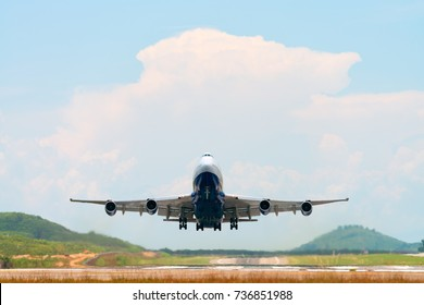 Airplane take off above airport runway at sunny day